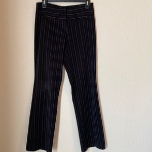 A pair of pinstripe dress pants.